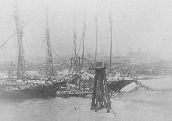 Two ships collided during the ?freshet? of May 1894 and are jammed against the South Street Bridge.